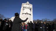Clifton Ross directs a choir at the Martin Luther King, Jr. Memorial, during the 9th Annual Wreath Laying and Day of Reflection…