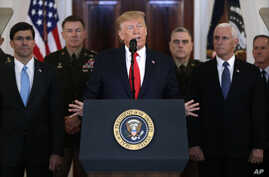 President Donald Trump addresses the nation from the White House on the ballistic missile strike that Iran launched against Iraqi air bases housing U.S. troops, Wednesday, Jan. 8, 2020, in Washington, as Vice President Mike Pence and others looks on…