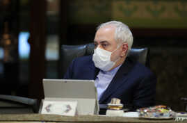 A handout picture provided by the Iranian presidency on March 11, 2020 shows Iranian Foreign Minister Mohmmad Javad Zarif…