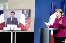 German Chancellor Angela Merkel addresses a joint press conference with French President Emmanuel Macron, who attends via video…