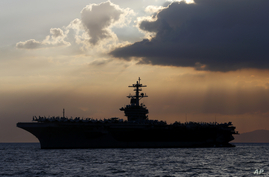 The U.S. aircraft carrier Theodore Roosevelt is anchored off Manila Bay to host top Philippine officials and businessmen in a…