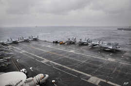 F18 aircrafts are parked on U.S. Navy aircraft carrier USS NIMITZ during the Malabar 2017 tri-lateral exercises between India,…