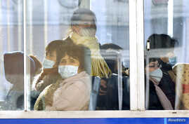 Passengers wear masks inside a trolley bus in Pyongyang, North Korea, in this photo taken February 22, 2020 and released by…
