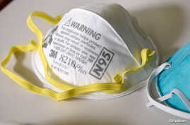 FILE PHOTO: Various N95 respiration masks at a laboratory of 3M, that has been contracted by the U.S. government to produce…