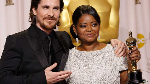 """Octavia Spencer with presenter Christian Bale and her award for best supporting actress in """"The Help."""" (AP)"""