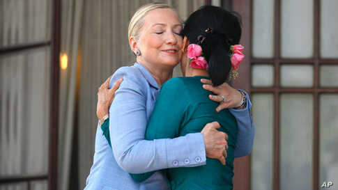 U.S. Secretary of State Hillary Clinton hugs Myanmar's pro-democracy leader Aung San Suu Kyi as they meet in Yangon December 2, 2011. (Reuters)