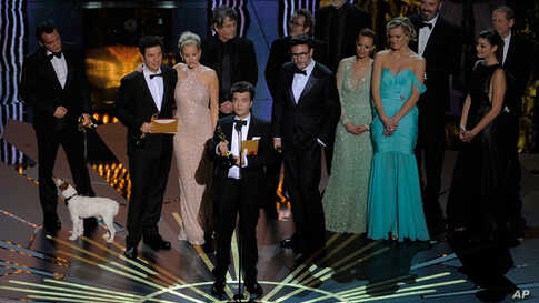 """Producer Thomas Langmann after accepting the Oscar for best picture  for """"The Artist"""" Feb. 26, 2012. (AP)"""