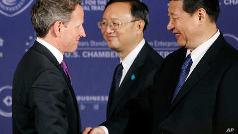 Treasury Secretary Tim Geithner greets Xi with Chinese Foreign Minister Yang Jiechi at the U.S. Chamber of Commerce in Washington, Tuesday, Feb. 14, 2012. (AP)