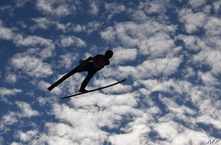 Ziga Jelar of Slovenia soars through the air during the men's HS130 ski jumping team event at the FIS Nordic World Ski Championships in Innsbruck, Austria, on February 24, 2019.
