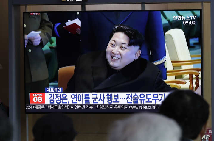 "FILE - People watch a TV news program reporting about North Korea's test-fire of a ""new-type tactical guided weapon,"" with a file footage of North Korean leader Kim Jong Un, at the Seoul Railway Station in Seoul, South Korea, April 18, 2019."