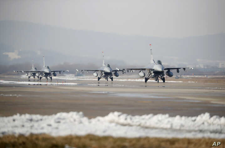 FILE - U.S. Air Force F-16 fighter jets take part in a joint aerial drills called Vigilant Ace between U.S and South Korea, at the Osan Air Base in Pyeongtaek, South Korea, Dec. 6, 2017.