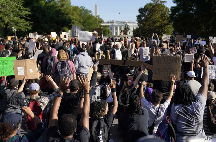 Demonstrators gather to protest the death of George Floyd, Monday, June 1, 2020, near the White House in Washington. Floyd died…