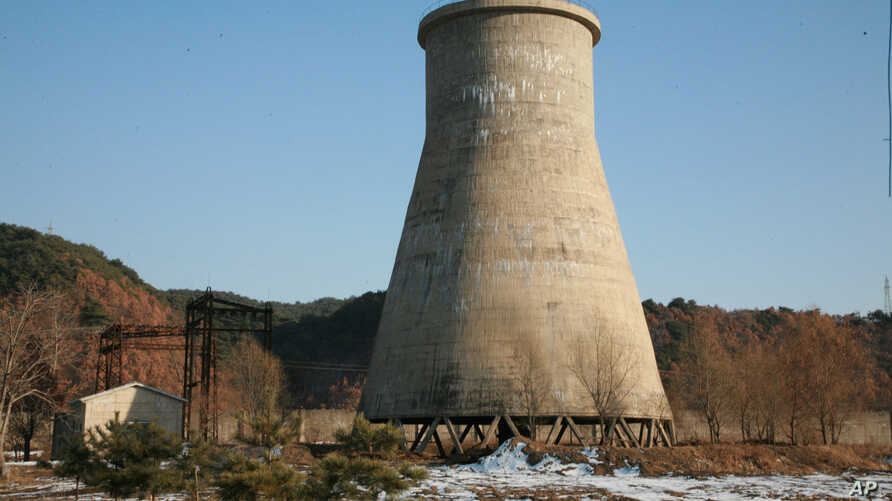 FILE - The file photo, taken Dec. 18, 2007, and released June 27, 2008, by the official Chinese news agency Xinhua, shows the cooling tower at the Yongbyon nuclear complex near Pyongyang, North Korea.