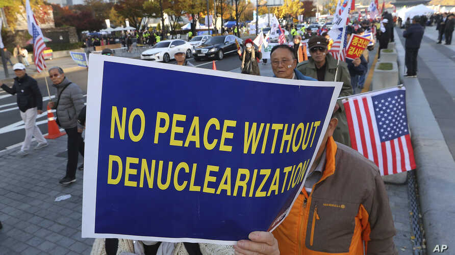 Protesters march toward the U.S. Embassy during a rally supporting the United States' policy to put steady pressure on North Korea in Seoul, South Korea, Nov. 3, 2018.
