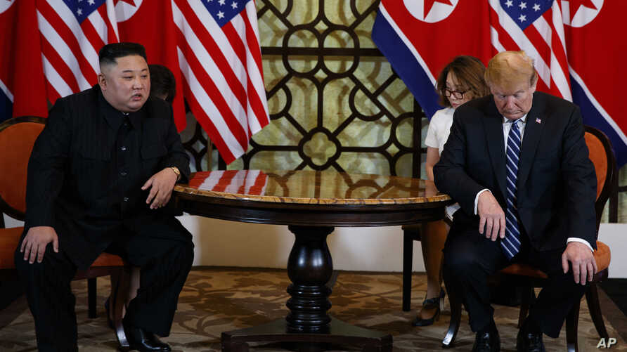 FILE - President Donald Trump meets North Korean leader Kim Jong Un in Hanoi., Feb. 28, 2019.