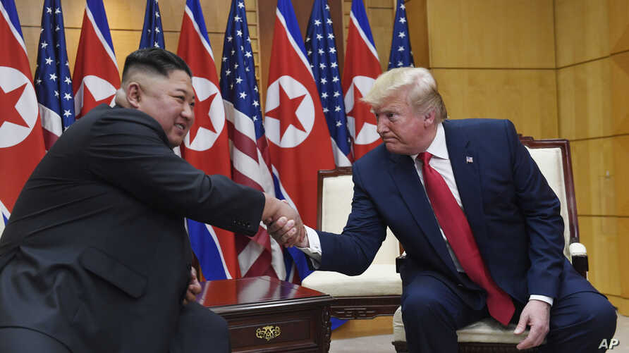 President Donald Trump meets with North Korean leader Kim Jong Un at the border village of Panmunjom in the Demilitarized Zone, South Korea,  June 30, 2019.