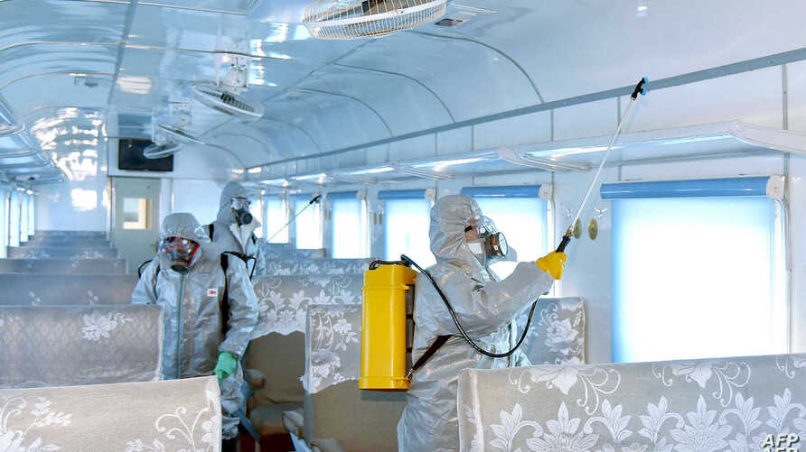A trolley bus is disinfected amid fears over the spread of the novel coronavirus in Pyongyang, North Korea, Feb. 22, 2020, and released by Kyodo on Feb. 23, 2020.