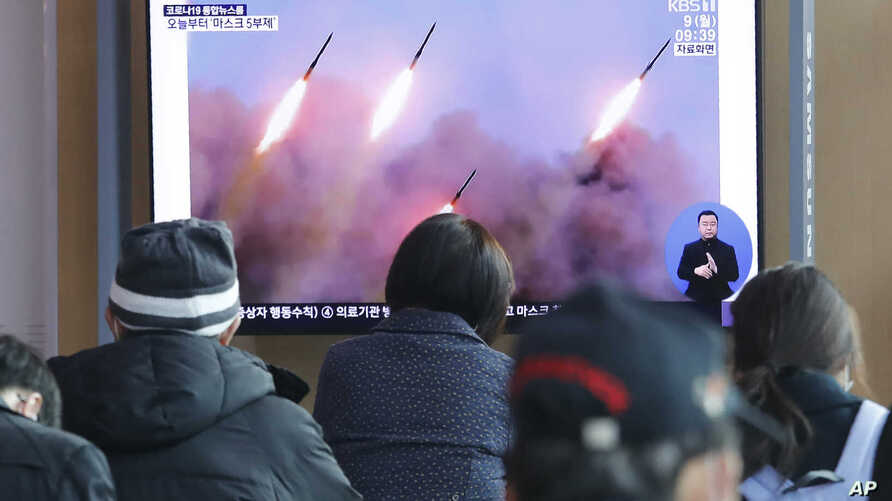 People watch a TV showing file images of North Korea's missile launch during a news program at the Seoul Railway Station in Seoul, South Korea, Monday, March 10, 2020.