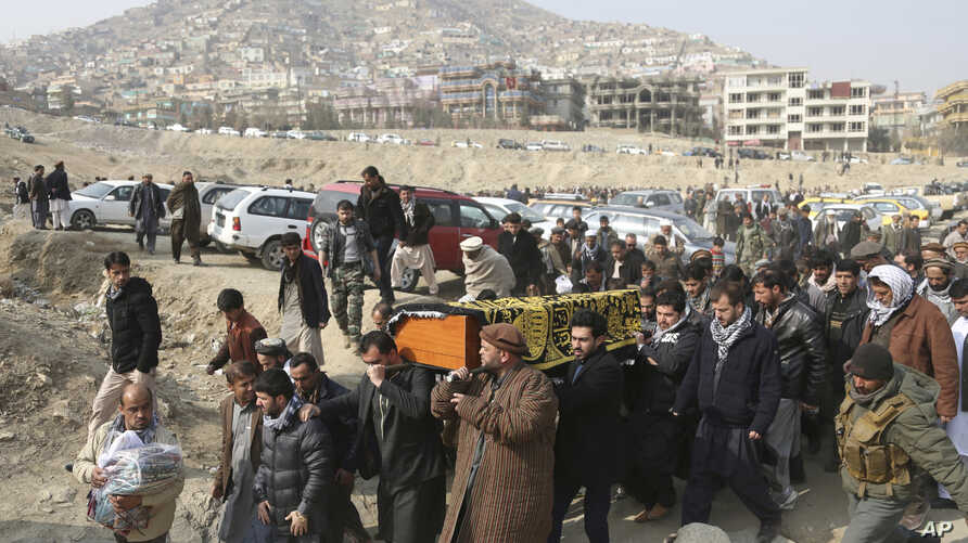 FILE - In this Jan. 28, 2018, file photo, men carry the coffin of a relative who died in the Jan. 27 deadly suicide attack in…