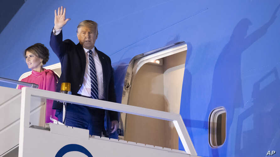 U.S.President Donald Trump, and first lady Melania Trump, wave as board Air Force One upon departure from at Indian Air Force…