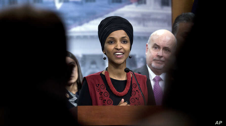 FILE - In this Wednesday, Jan. 8, 2020, file photo, Congressional Progressive Caucus member Rep. Ilhan Omar, D-Minn., and…
