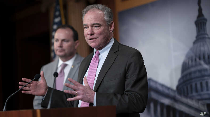 Sen. Tim Kaine, D-Va., joined at left by Sen. Mike Lee, R-Utah, meets with reporters just after the Senate advanced a…