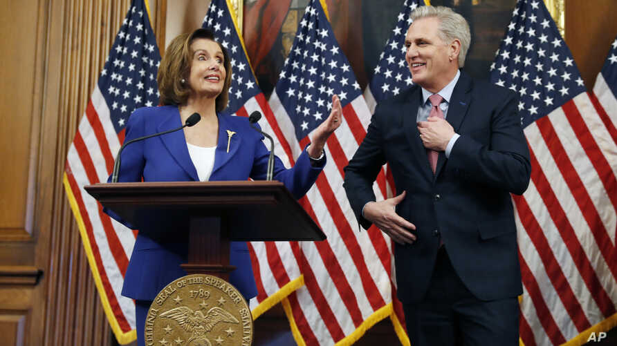 House Speaker Nancy Pelosi of Calif., accompanied by House Minority Leader Kevin McCarthy of Calif., participates in a bill…