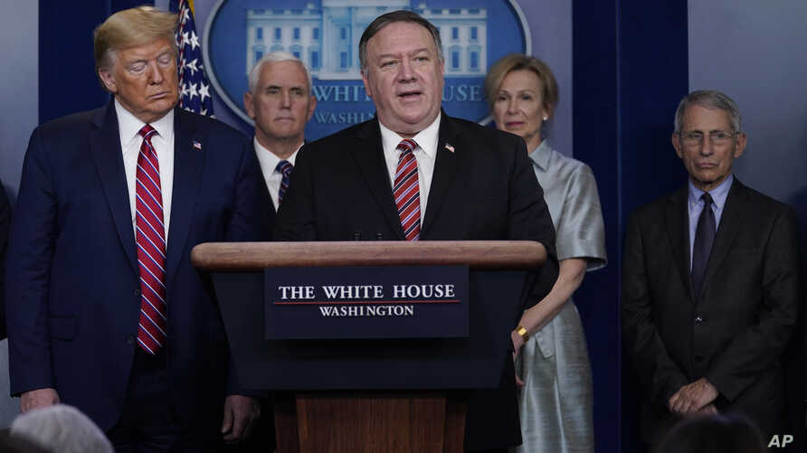 President Donald Trump listens as Secretary of State Mike Pompeo speaks during a coronavirus task force briefing at the White…