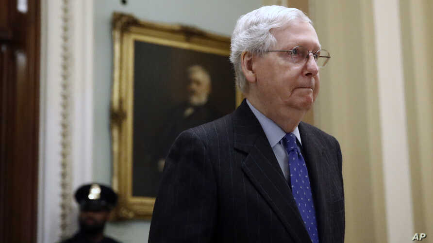 Senate Majority Leader Mitch McConnell of Ky., walks out of the Senate chamber on Capitol Hill in Washington, Tuesday, March 24…