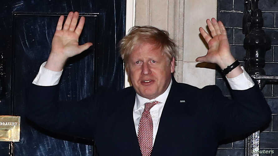 Britain's Prime Minister Boris Johnson applauds outside 10 Downing Street during the Clap For Our Carers campaign in support of…
