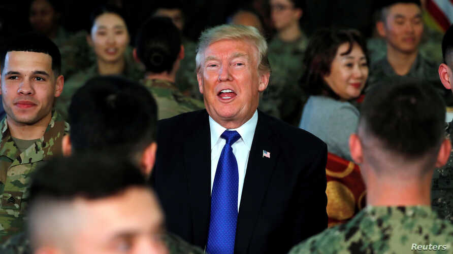 U.S. President Donald Trump has lunch with troops at U.S. military installation Camp Humphreys in Pyeongtaek, South Korea,…