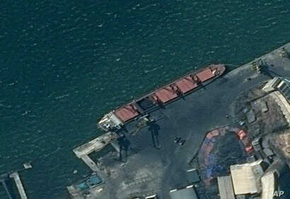 This satellite image provided by the Department of Justice shows what the DoJ says is the North Korean cargo ship Wise Honest docked at a unknown port.