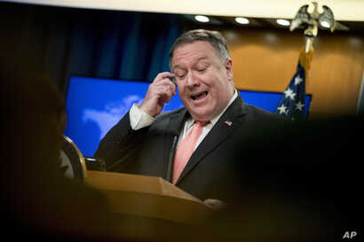 Secretary of State Mike Pompeo speaks to reporters at a news conference at the State Department in Washington, Oct. 23, 2018.