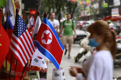U.S and North Korean flags are on sale at a flag shop in Hanoi, Vietnam, Jan. 29, 2019. Vietnam's selection as the venue for the second summit between U.S. President Donald Trump and North Korean leader Kim Jong Un is largely a matter of convenience an...