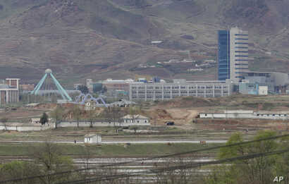 FILE - The Kaesong industrial complex in North Korea is seen, April 24, 2018, from the Taesungdong freedom village inside the demilitarized zone during a press tour in Paju, South Korea. The rival Koreas, on Sept. 14, 2018, have opened their first liai...