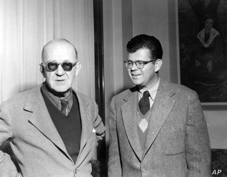 """Film director John Ford, left, and his son Patrick are seen at  their hotel in Rome on Feb. 2, 1953.  John Ford, director  """"The…"""