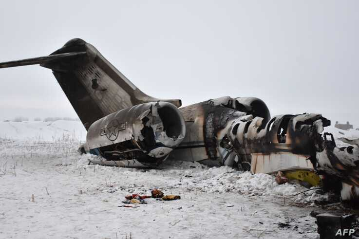 TOPSHOT - In this photograph taken on January 27, 2020 the wreckage of a US Bombardier E-11A jet is seen after it crashed in…